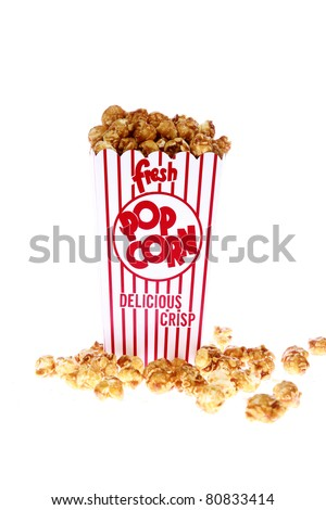 pop corn, caramel corn, snack, hot popcorn - a box of fresh popped Caramel Corn also known as Caramel corn or Caramel Popcorn. isolated on white with room for your text