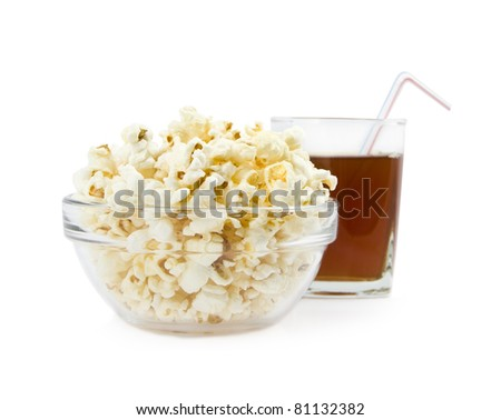 pop-corn in a dish on a background glass with drink isolated
