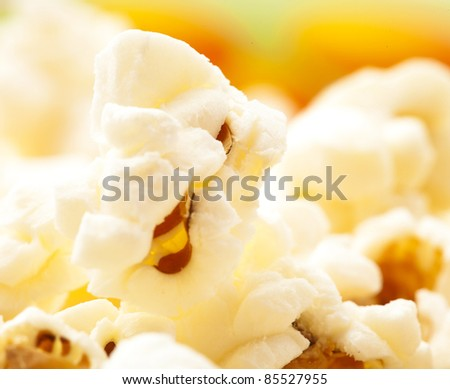 pop corn on a bowl, extreme closeup photo