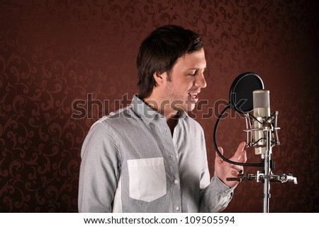 Pop singer singing a song in the recording Studio