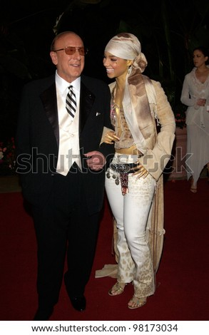 Pop star ALICIA KEYES with J Records boss CLIVE DAVIS at pre-Grammy party given by Clive Davis of J Records at the Beverly Hills Hotel. 25FEB2002   Paul Smith / Featureflash