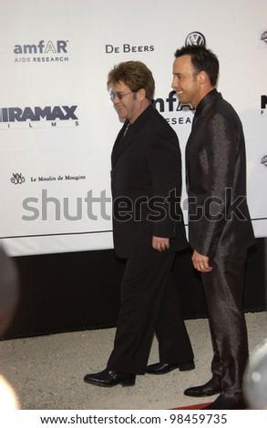 Pop star SIR ELTON JOHN & boyfriend DAVID FURNISH at Le Moulin de Mougins restaurant for amfAR's Cinema Against AIDS 2003 Gala. 22MAY2003 - stock photo