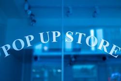 Pop up store entrance glass door.