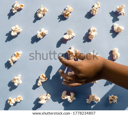 Popcorn arranged neatly on a colorful background Conceptual of obsessive compulsive disorder. Pop art style  Stock photo ©