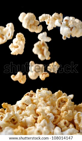 popcorn background, closeup shot of popcorn with falling popcorn
