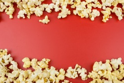 Popcorn. Food concept. Empty space for text and design. Red background