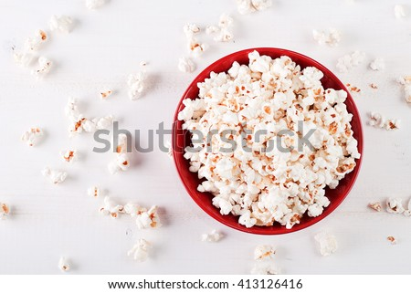 popcorn in a red bowl top view