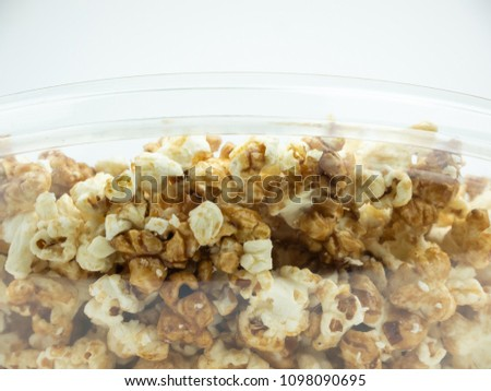 Popcorn in bowl on white background. #1098090695