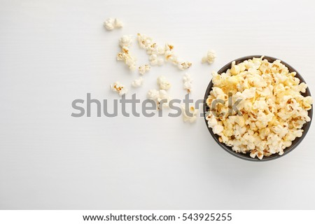 Popcorn in bowl on white background #543925255