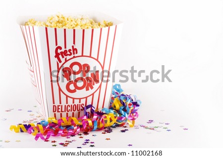 Popcorn in large bucket with confetti and streamers