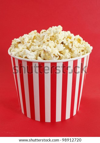 Popcorn in red and white cardboard box for cinema