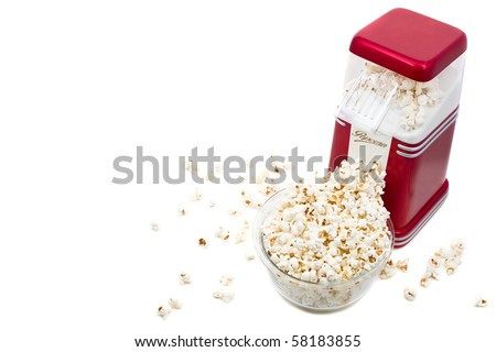 Popcorn machine with popcorn over white background