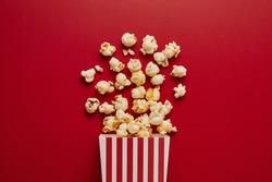 Popcorn on color background .