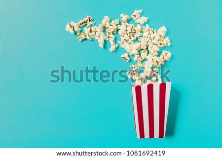 popcorn on color background #1081692419