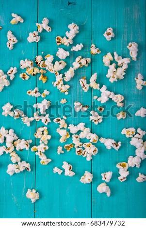 popcorn on the blue background #683479732