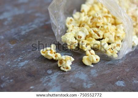 Popcorn on wood #750552772