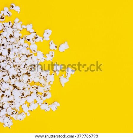 Popcorn on yellow background. Minimalism Fashion detail.