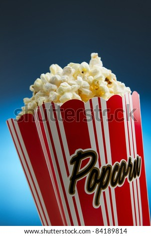 Popcorn over blue background