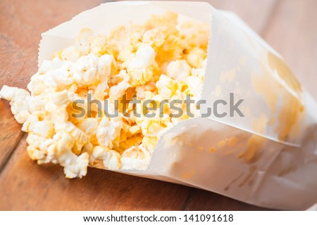 Popcorn packet opened with corn spilling out