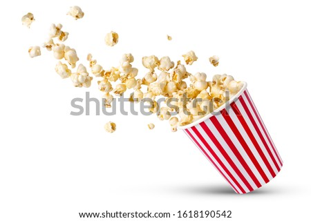 Photo of  Popcorn viewed float Paper cup with popcorn on white isolated