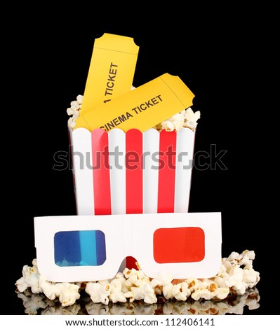 popcorn with glasses and tickets isolated on black