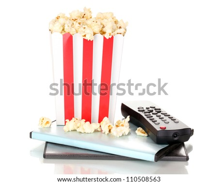 popcorn with TV control panel and disks isolated on white