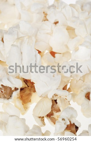 Popped popcorn kernels useful as a background  or texture.