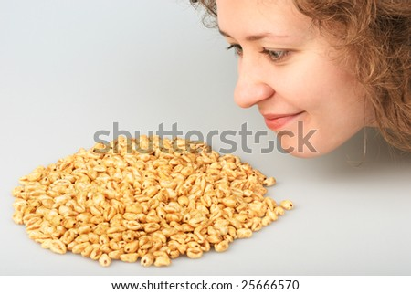 Popped wheat grains and beautiful girl