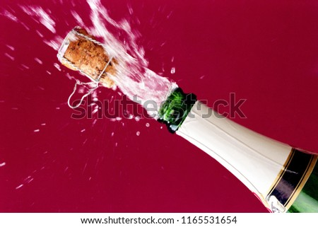 Popping Bottle of Champagne #1165531654
