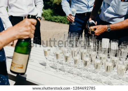 Popping bottles to celebrate bride and groom, wedding toast, hands #1284692785