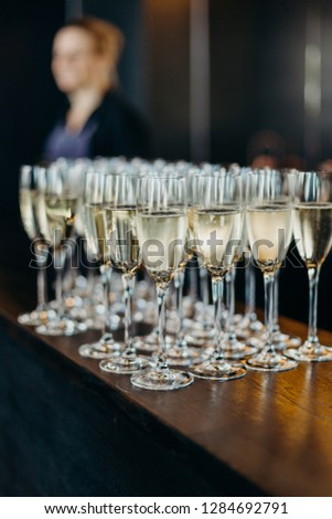 Popping bottles to celebrate bride and groom, wedding toast, hands #1284692791