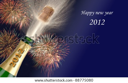 popping champagne at new year 2012