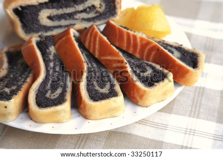 poppy pie served on dish with lemon - stock photo