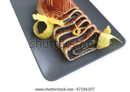 poppy pie served on dish with lemon