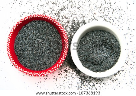 Poppy Seeds in the two plates on white background