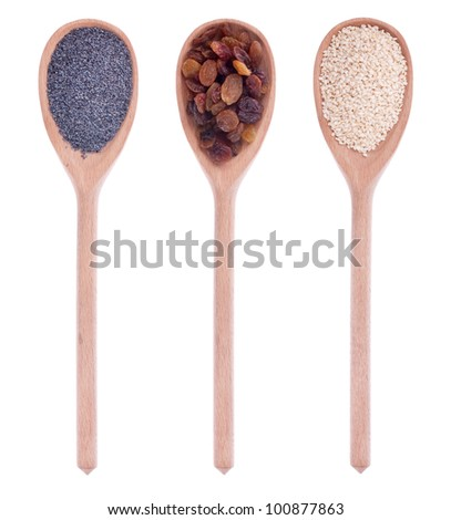 poppy seeds, raisins, sesame seeds in a wooden spoon, isolated on white background