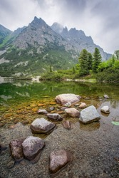 Popradske pleso - tarn in High Tatras mountains, Slovakia. Charming view of the mountains from the shore of the lake.