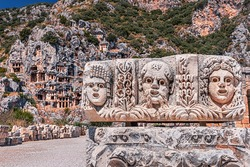 Popular archaeological site and ancient city of Myra in Turkey - historical landmark that attracts numerous excursions and tourists every day. The tombs and basrelief are carved right into the rock