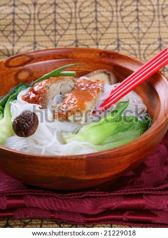 Popular Asian Cuisine; Slices of Roasted Peking Duck with Rice Noodles Soup Bowl