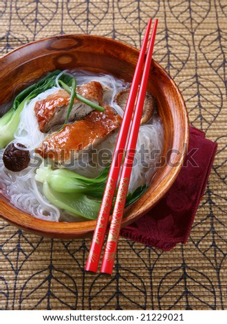 Popular Asian Cuisine - Slices of Roasted Peking Duck with Rice Noodles Soup Bowl
