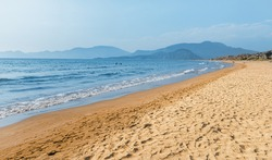 Popular resort Iztuzu beach with fine yellow sand awaits vacationers and tourists in Turkey, near Dalyan. Sea paradise and relaxation concept. This place is famous by Loggerhead turtle nesting spot