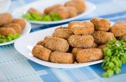 Popular side dish Croquetas fritas on plates