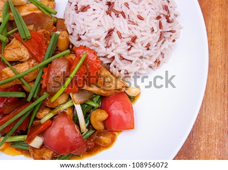 Popular thai and chinese dish: stir-fried chicken with cashew nut. Served with red and white rice. Delicious!