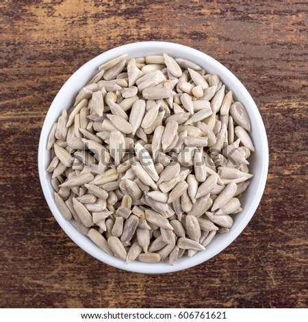 Porcelain bowl with peeled sunflower seeds / sunflower seeds / sunflower seeds #606761621