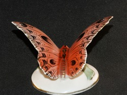 Porcelain butterfly figurine isolated on black background