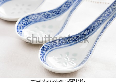 Porcelain chinese spoon with blue hand painted decoration.