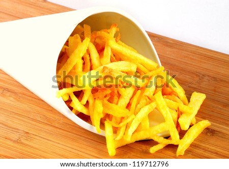 Porcelain cone of chips on wood table. - stock photo