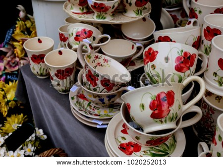Porcelain cup with flowers, red poppies