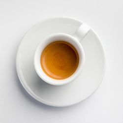 porcelain espresso coffee cup with saucer on white background. top view