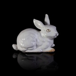 porcelain figurine of a rabbit. easter white bunny. antique figurine